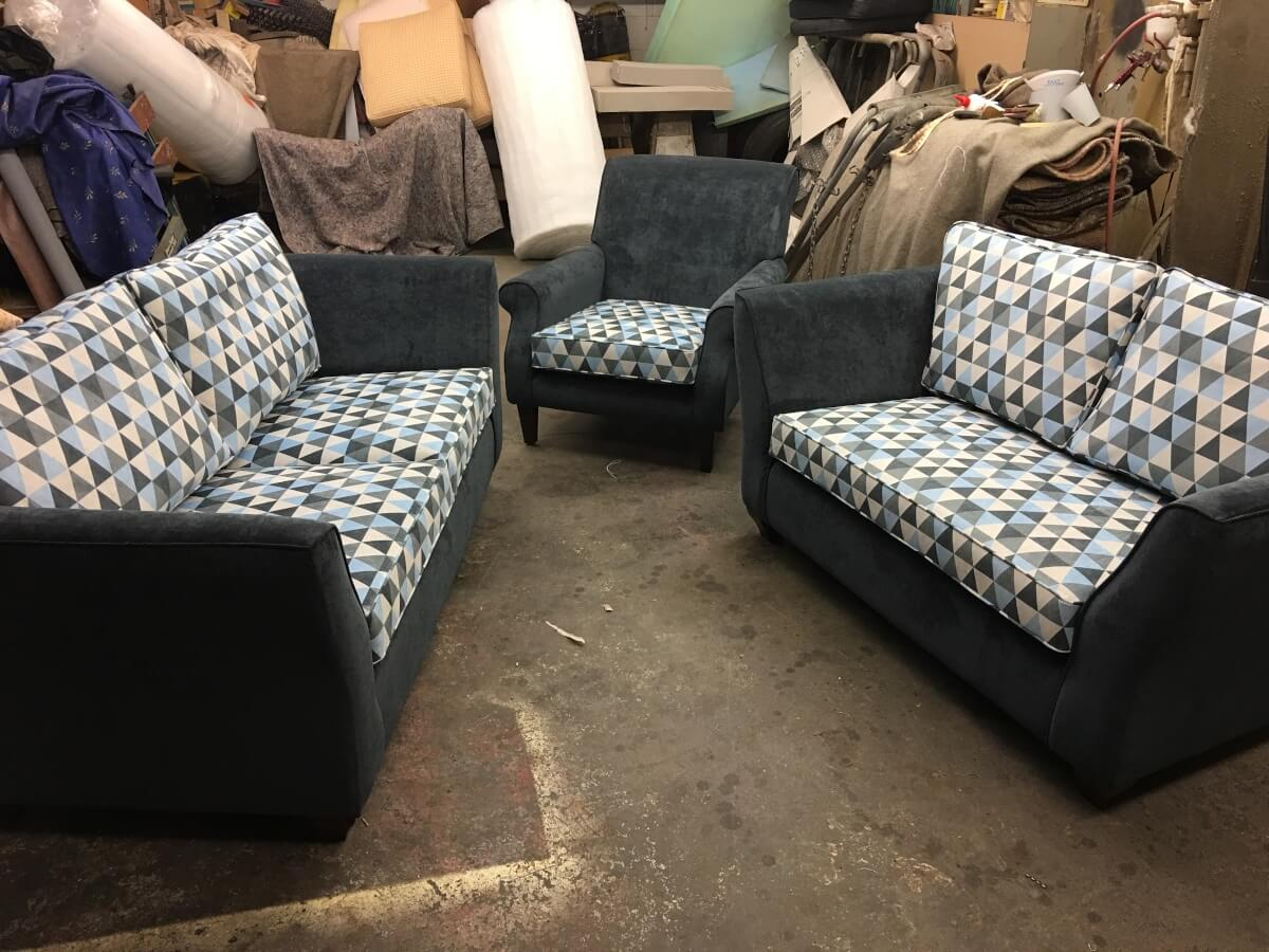 Sofas and chairs in upholstery workshop, Leicester