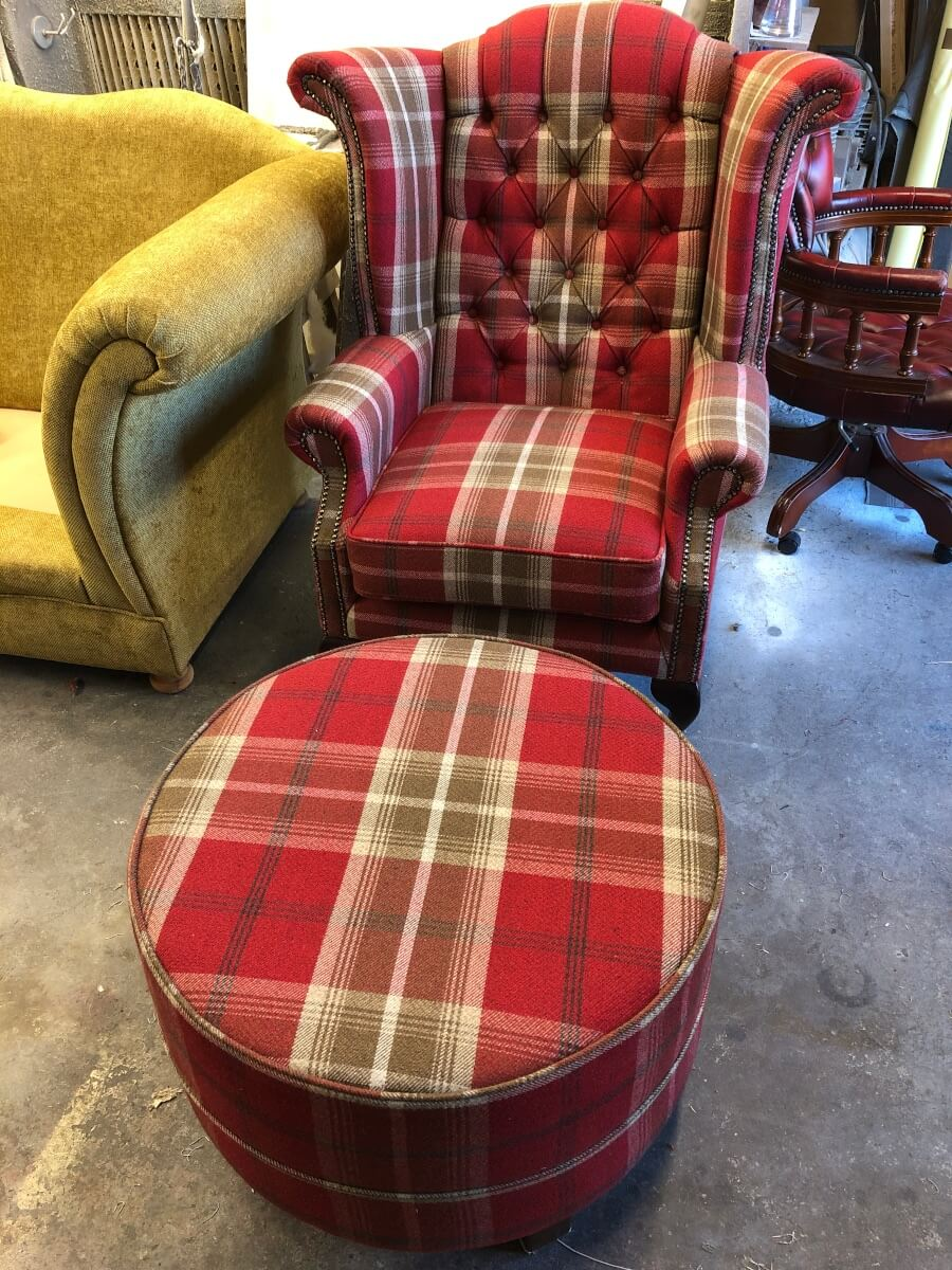 Armchair and footstool in upholstery workshop, Leicester